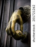 Old Door Handle With A Hand...