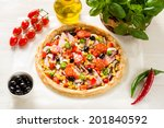 preparing a pizza on a wooden... | Shutterstock . vector #201840592