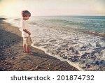 little boy playing on the beach | Shutterstock . vector #201874732