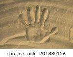 Print Of Hand On Sand