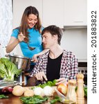 young  couple cooking together ... | Shutterstock . vector #201883822
