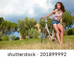 sexy woman with vintage bike in ... | Shutterstock . vector #201899992