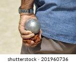Man playing jeu de boules or also called petanque. - stock photo