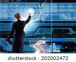 rear view of businesswoman... | Shutterstock . vector #202002472