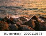 Sunset On A Rocky Stone Beach....