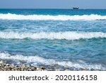 Three Waves Near The Shore. A...
