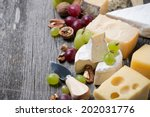 cheeses  grapes and walnuts on... | Shutterstock . vector #202031776