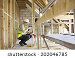 construction worker using drill ... | Shutterstock . vector #202046785