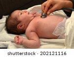 midwife checks newborn baby... | Shutterstock . vector #202121116