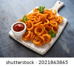 Spicy Curly Fries With Ketchup...