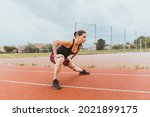 female runner warms up on the...   Shutterstock . vector #2021899175