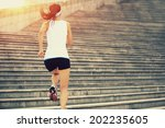 runner athlete running on... | Shutterstock . vector #202235605