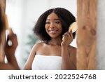 Cheerful Afro Woman Brushing...
