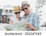 young tourist couple consulting ... | Shutterstock . vector #202267165