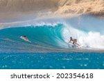 surfing a wave. lombok island.... | Shutterstock . vector #202354618