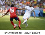 Small photo of BELO HORIZONTE, BRAZIL - June 24, 2014: Cristian GAMBOA of Costa Rica and Luke SHAW of England compete for the ball during the World Cup Group D game between Costa Rica and England at Estadio Mineirao