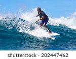 surfing a wave. lombok island.... | Shutterstock . vector #202447462