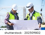 engineers at construction site | Shutterstock . vector #202509802