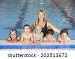children having swimming lesson | Shutterstock . vector #202513672
