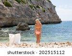 woman at the beach | Shutterstock . vector #202515112
