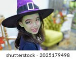 Cute Child With Witch Costume...