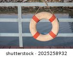 An Old Lifebuoy Hangs On A Blue ...