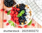 bowl of granola with rip...   Shutterstock . vector #2025303272