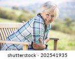 senior woman sitting outdoors | Shutterstock . vector #202541935