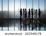 business colleagues talking in... | Shutterstock . vector #202548178