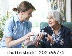 nurse advising senior woman on... | Shutterstock . vector #202566775