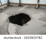 Large Hole In The Asphalt  A...