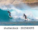 surfing a wave. lombok island.... | Shutterstock . vector #202583095