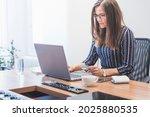 businesswoman pays for an...   Shutterstock . vector #2025880535
