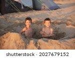 Two Boys Dug A Huge Sand Hole...