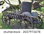 An Old Wooden Cart With A...