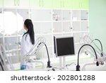 student dentist in office | Shutterstock . vector #202801288