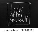 Small photo of Look After Yourself written on a used blackboard