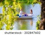 loving couple in the boat.... | Shutterstock . vector #202847602