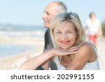 smiling tanned mature woman at... | Shutterstock . vector #202991155