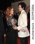 Постер, плакат: Christina Hendricks & husband