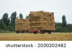 Two Flatbed Bale Wagons On The...