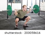 squat workout at fitness gym...   Shutterstock . vector #203058616