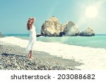 girl looking to the sea near... | Shutterstock . vector #203088682