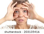 tired woman opening her eyes... | Shutterstock . vector #203135416