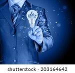 business man touching light of... | Shutterstock . vector #203164642