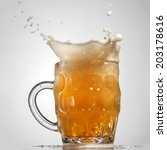 Beer Splash In Glass Isolated...