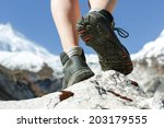 hiking boots on the rock in the ... | Shutterstock . vector #203179555