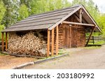 Wooden Shed And Prepared Logs...