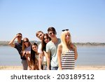 group of friends at beach | Shutterstock . vector #203189512
