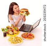 woman eating fast food at work. ... | Shutterstock . vector #203235472